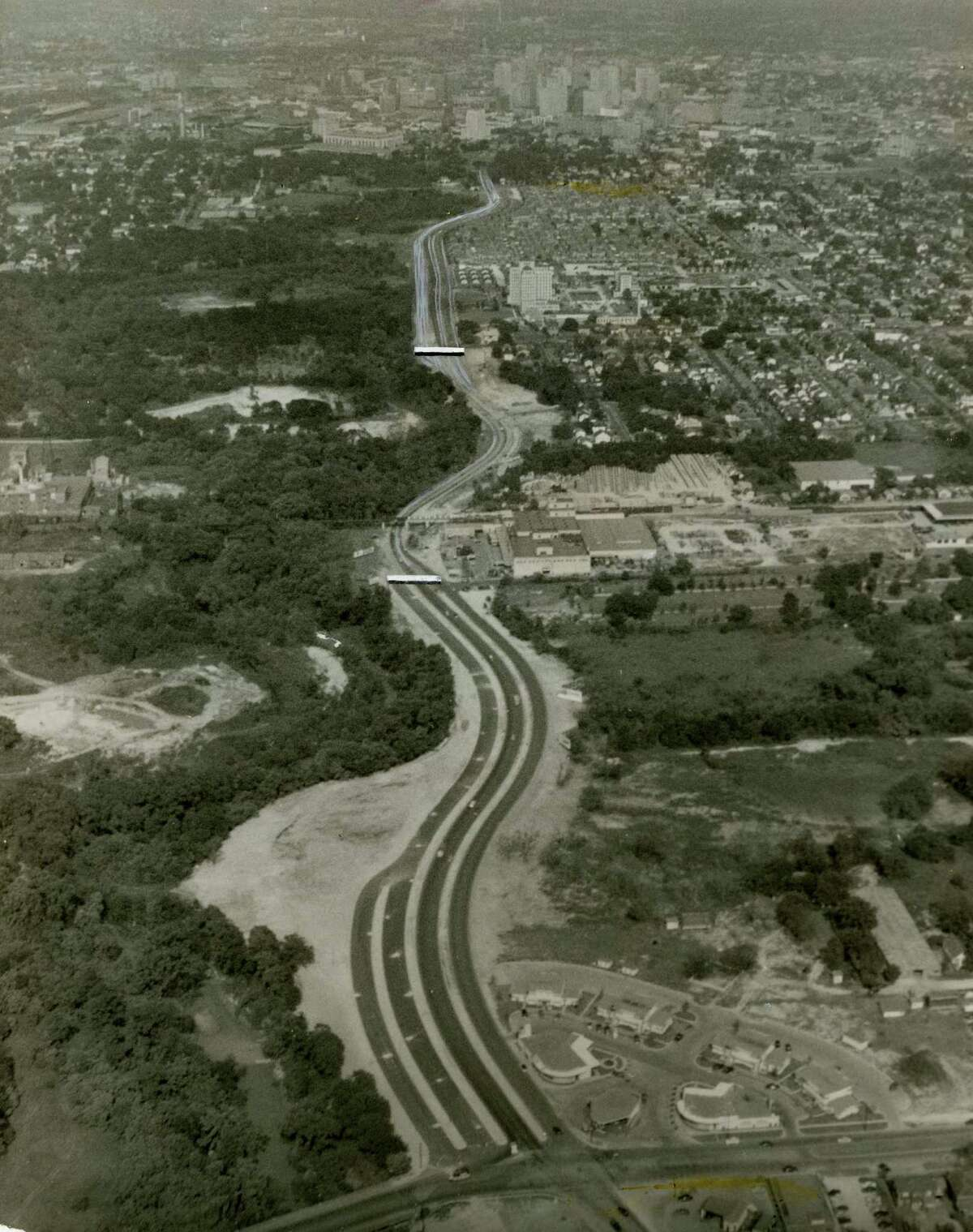 """Once a two-lane road, Buffalo Drive was widened in 19050 and gained a system of entrance and exit ramps that earned it the nickname """"Spaghetti Bowl."""" It later was renamed Allen Parkway."""