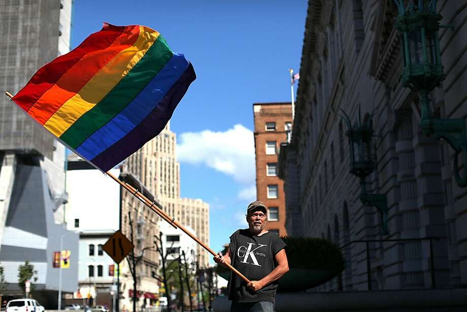 Bob Sodervick waves a gay pride flag outside of the Ninth U.S. Circuit Court of Appeals on June 5, 2012 in San Francisco, California. A federal appeals court announced that it will not rehear arguments on the California's controversial Prop 8 same-sex ban paving the way for the case to go to the U.S. Supreme Court. Photo: Justin Sullivan, Getty Images