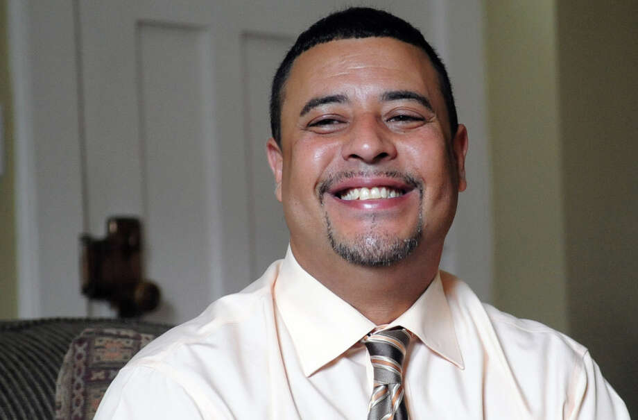Miguel Vargas sits in his Stamford home and talks about earning his GED from the Adult Education program. Photo: Lindsay Niegelberg / Stamford Advocate