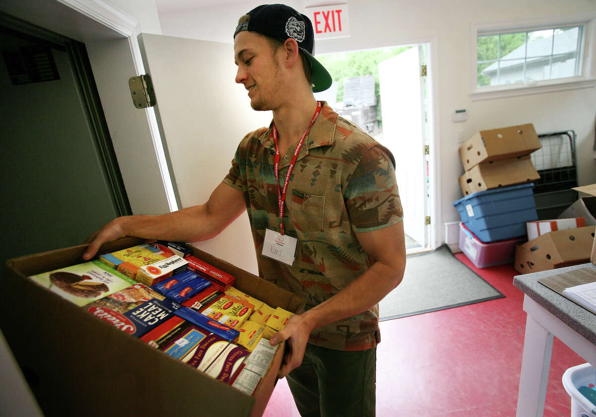 Person-to-Person Amount raised: $11,234 Number of Donors: 70 Pictured: Karl Hueglin, of Wilton, moves boxes of food while volunteering at Person-to-Person in Darien on Tuesday, June 5, 2012. Person-to-Person utilizes the website, volunteersquare.org, to find volunteers.