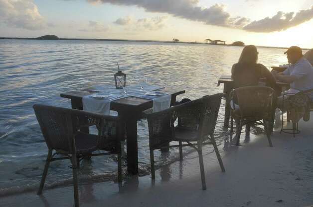 Patrons can dine with their toes in the sand -- or the water -- at the Flying Fishbone. Photo: Melissa Ward Aguilar