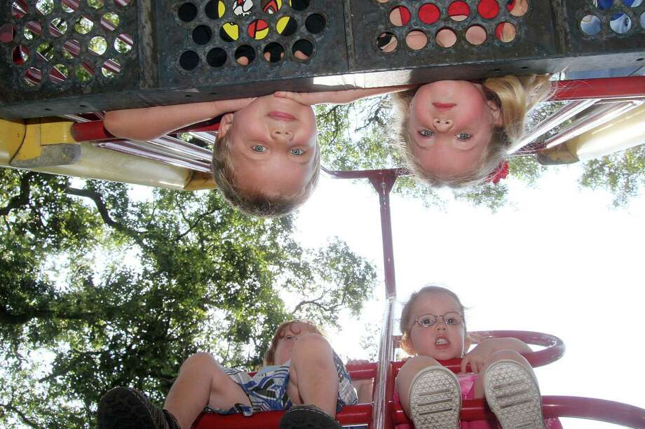 Enjoying playtime at Sealy Park in Alvin are, from bottom clockwise, Dolye King, 2; Hailey King, 4; J.J. Ledbetter, 5; and Addie Ledbetter, 4. Alvin is one of the 14 cities  in Texas named Playful City USA 2012. Photo: Pin Lim / Copyright Pin Lim.