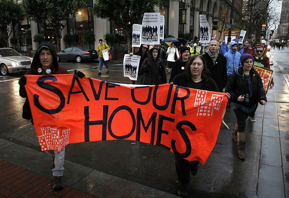 A group marches down Market St. to join members of Occupy SF and other supporters for a rally at Justin Herman Plaza,  during a national day of action against corporations and financial institutions in San Francisco, Calif. on Friday, Jan. 20, 2012. Photo: Michael Macor, SFC
