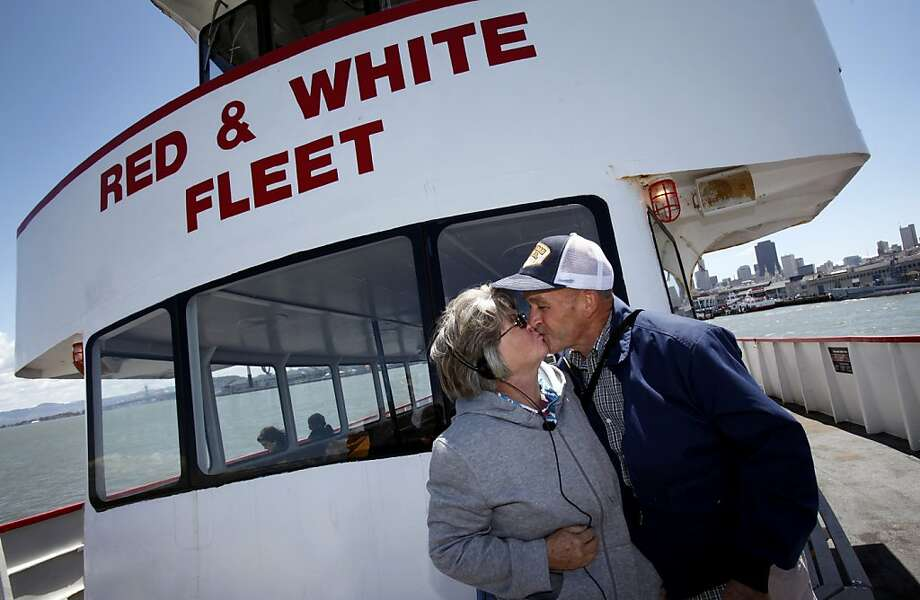 Larry Richardson told his wife Barbara he'd give her a kiss as soon as they came into view of the Golden Gate bridge in person, and he made good on that promise on their boat tour in San Francisco, Calif. Tuesday, June 5, 2012.  The Richardsons built a replica of the Golden Gate bridge on their property in Kansas, and traveled to see the real bridge up close. Photo: Sarah Rice, Special To The Chronicle