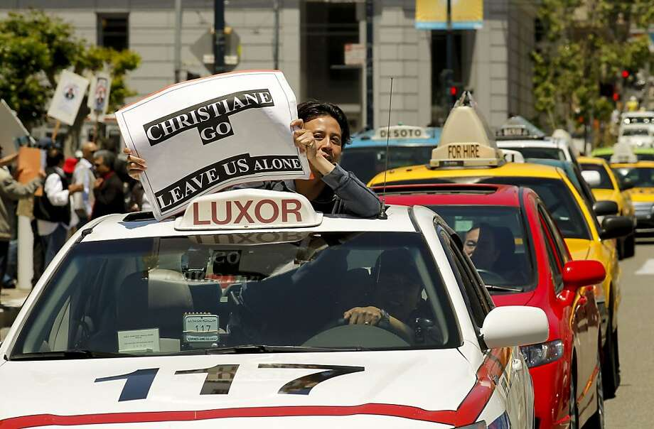 Taxi driver Danny Nguyen joins a line of San Francisco cab drivers and owners protesting by circling City Hall on Tuesday June 5, 2012, in San Francisco, Ca., before the meeting of the San Francisco Municipal Transportation Agency. Photo: Michael Macor, The Chronicle