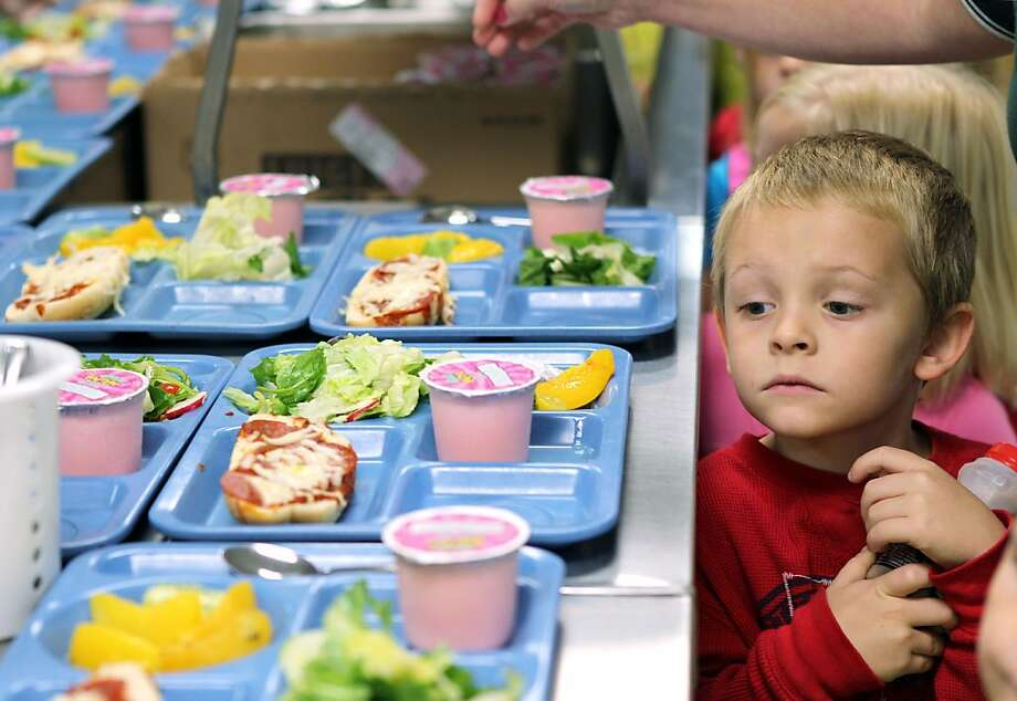 In this Tuesday, Nov. 1, 2011 file photo pre-K student Titus Bailey waitd in line for his lunch tray at West Hamlin Elementary School in West Hamlin, W. V. The nation's school districts are turning up their noses at ?pink slime,? the beef product that caused a public uproar earlier this year. The U.S. Department of Agriculture says the vast majority of states participating in its National School Lunch Program have opted to order ground beef that doesn't contain the product known as lean finely textured beef. (AP Photo/The Herald-Dispatch, Lori Wolfe) Photo: Lori Wolfe, Associated Press