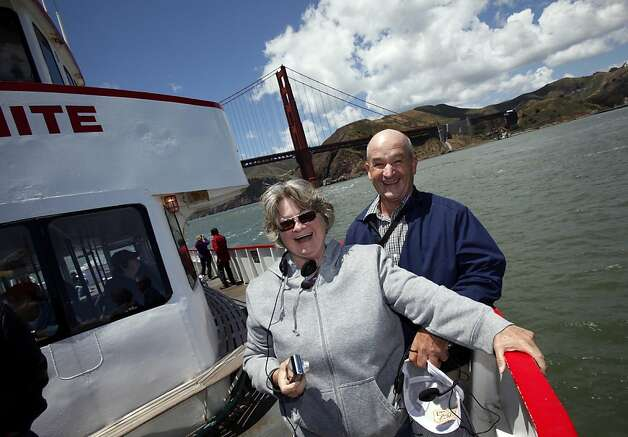 Larry and Barbara Richardson are all smiles after going under the Golden gate bridge on a boat tour in San Francisco, Calif. Tuesday, June 5, 2012.  The Richardsons built a replica of the Golden Gate bridge on their property in Kansas, and traveled to see the real bridge up close. Photo: Sarah Rice, Special To The Chronicle