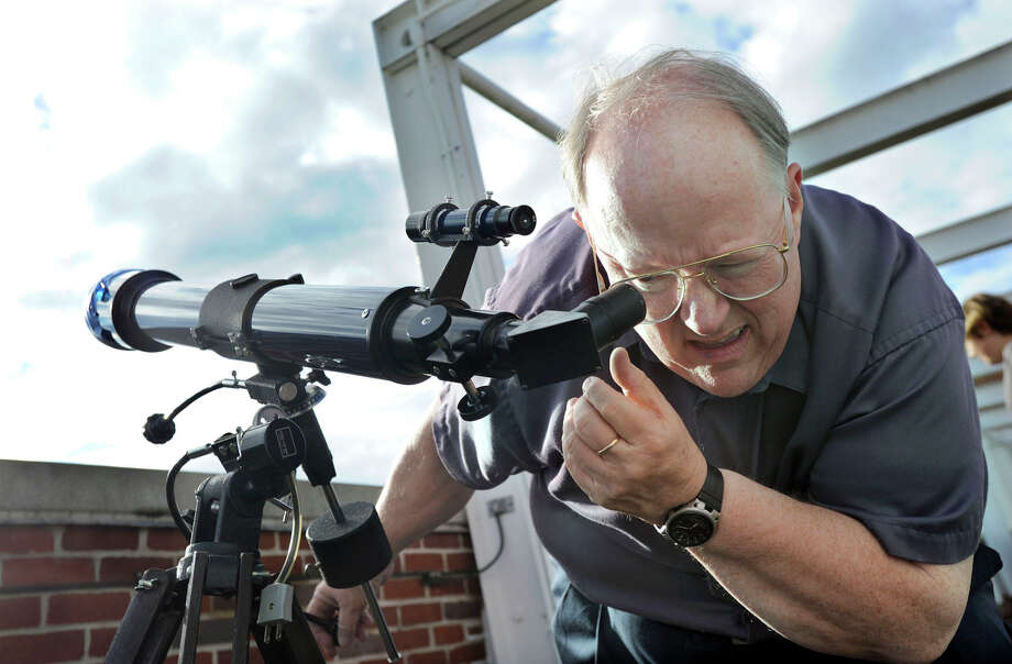 Dennis Dawson, professor of astronomy at Western Connecticut State University, adjusts one of the telescopes on the roof of the school's Science Building in preparation for viewing the Transit of Venus, Tuesday evening, June 5, 2012. Photo: Carol Kaliff