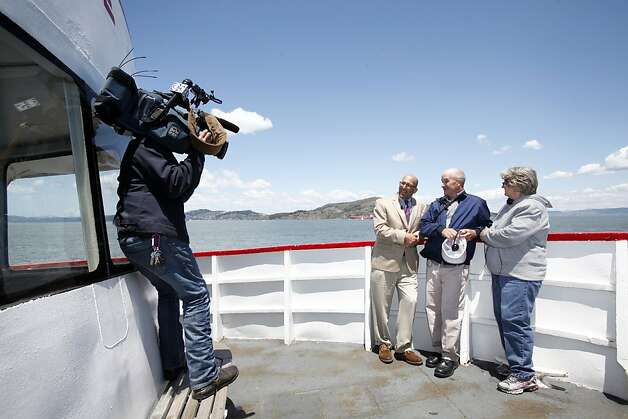 Larry and Barbara Richardson are interviewed by the media during a boat tour in San Francisco, Calif. Tuesday, June 5, 2012.  The Richardsons built a replica of the Golden Gate bridge on their property in Kansas, and traveled to see the real bridge up close. Photo: Sarah Rice, Special To The Chronicle