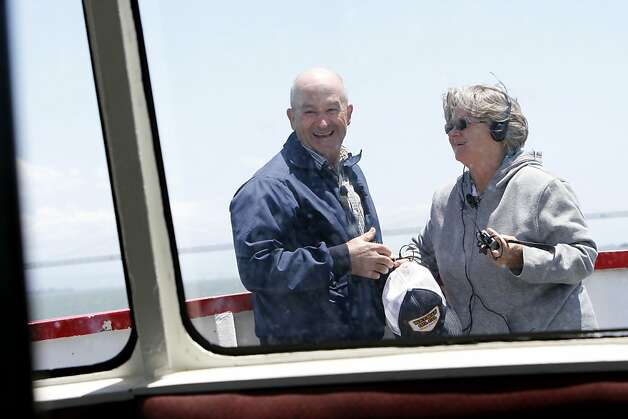 Larry and Barbara Richardson take a boat tour in San Francisco, Calif. Tuesday, June 5, 2012.  The Richardsons built a replica of the Golden Gate bridge on their property in Kansas, and traveled to see the real bridge up close. Photo: Sarah Rice, Special To The Chronicle