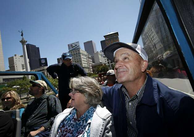 Larry and Barbara Richardson take a double-decker bus tour of downtown San Francisco, Calif. Tuesday, June 5, 2012.  The Richardsons built a replica of the Golden Gate bridge on their property in Kansas, and traveled to see the real bridge up close. Photo: Sarah Rice, Special To The Chronicle