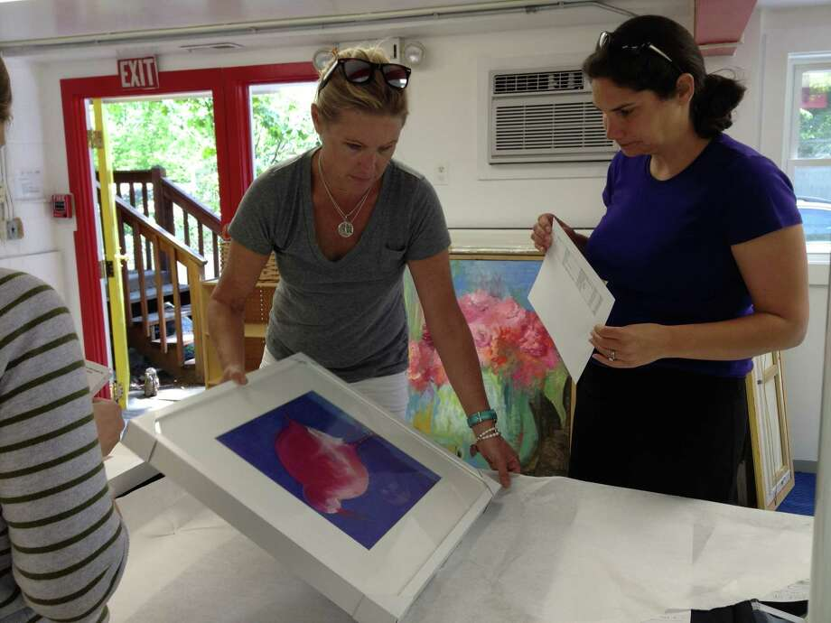 Rowayton Artist Lisa McHugh, left, delivers her artwork for the Community Cooperative Nursery School 50th Anniversary Art Show. School parent volunteer Emily Grabowski, right, is in charge of collecting artwork. The show will run Thursday, June 7, to Sunday, June 10, 2012, at the school, which is located at 4 Trolley Place, Rowayton, Conn. For more information about the show, including admission prices, visit www.ccnsartshow.org. Photo: Contributed Photo