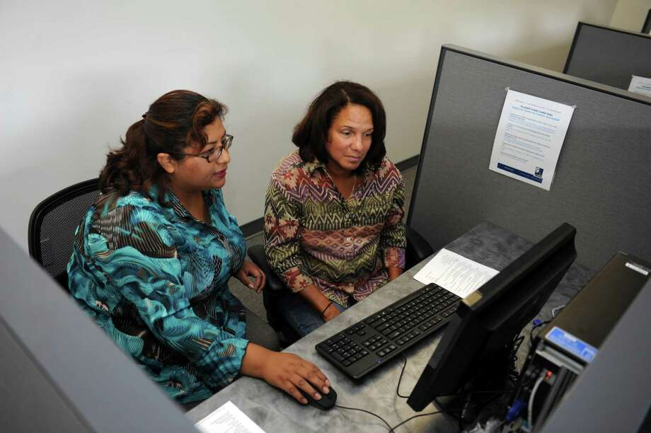 Priscila Hurtado, left, helps Hilaria Stubbs, of Westwood, N.J., with her resume and applications at the Greenwich Career Center free of charge Tuesday, June 5, 2012. To better serve southern Fairfield County communities, Goodwill of Western & Northern Connecticut has opened a Greenwich location at 1143 E. Putnam Ave. The donation station portion of the facility opened in November 2011. Goodwill programs and services, including the Transitional Employment Program, currently serving 16 individuals and previously housed in Stamford, moved in the first week of May. Photo: Helen Neafsey / Greenwich Time