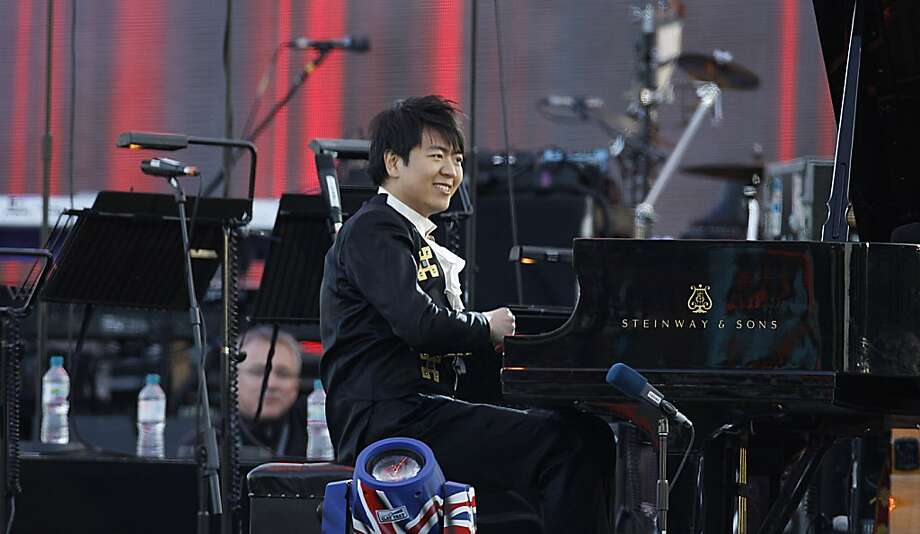 Lang Lang performs at the Queen's Jubilee Concert in front of Buckingham Palace, London, Monday, June 4, 2012. The concert is a part of four days of celebrations to mark the 60 year reign of Britain's Queen Elizabeth II. (AP Photo/Joel Ryan) Photo: Joel Ryan, Associated Press