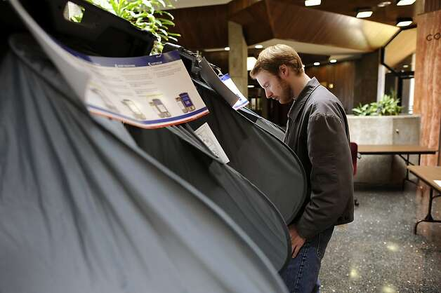 Jonathan Stockhus stands at a voting machine as he casts his vote at City Hall in Daly City.  California held it's primary election June 5th, 2012. Photo: Michael Short, Special To The Chronicle