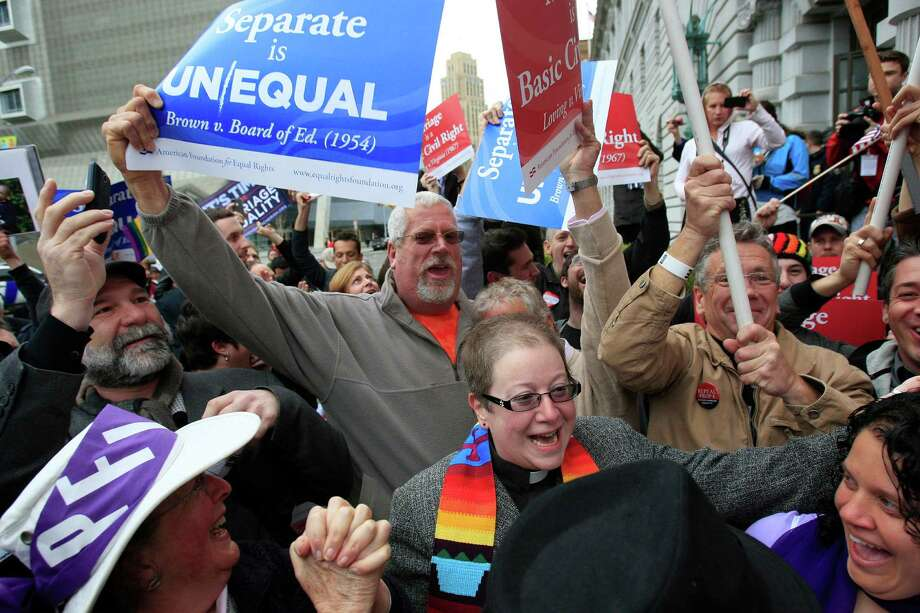 FILE - In this Feb. 7, 2012, file photo, supporters of gay marriage react outside the James R. Browning United States Courthouse after a federal appeals court declared California's ban on same-sex marriage unconstitutional in San Francisco. A federal appeals court refused Tuesday, June 5, 2012, to reconsider a landmark ruling by two of its member judges that struck down California's ban on same-sex marriages. Backers of the ban, known as Proposition 8, petitioned the full 9th U.S. Circuit Court of Appeals in February to review the decision instead of appealing directly to the U.S. Supreme Court. (AP Photo/San Francisco Chronicle, Lea Suzuki, File) NORTHERN CALIFORNIA MANDATORY CREDIT PHOTOG & CHRONICLE; MAGS OUT; NO SALES Photo: Lea Suzuki