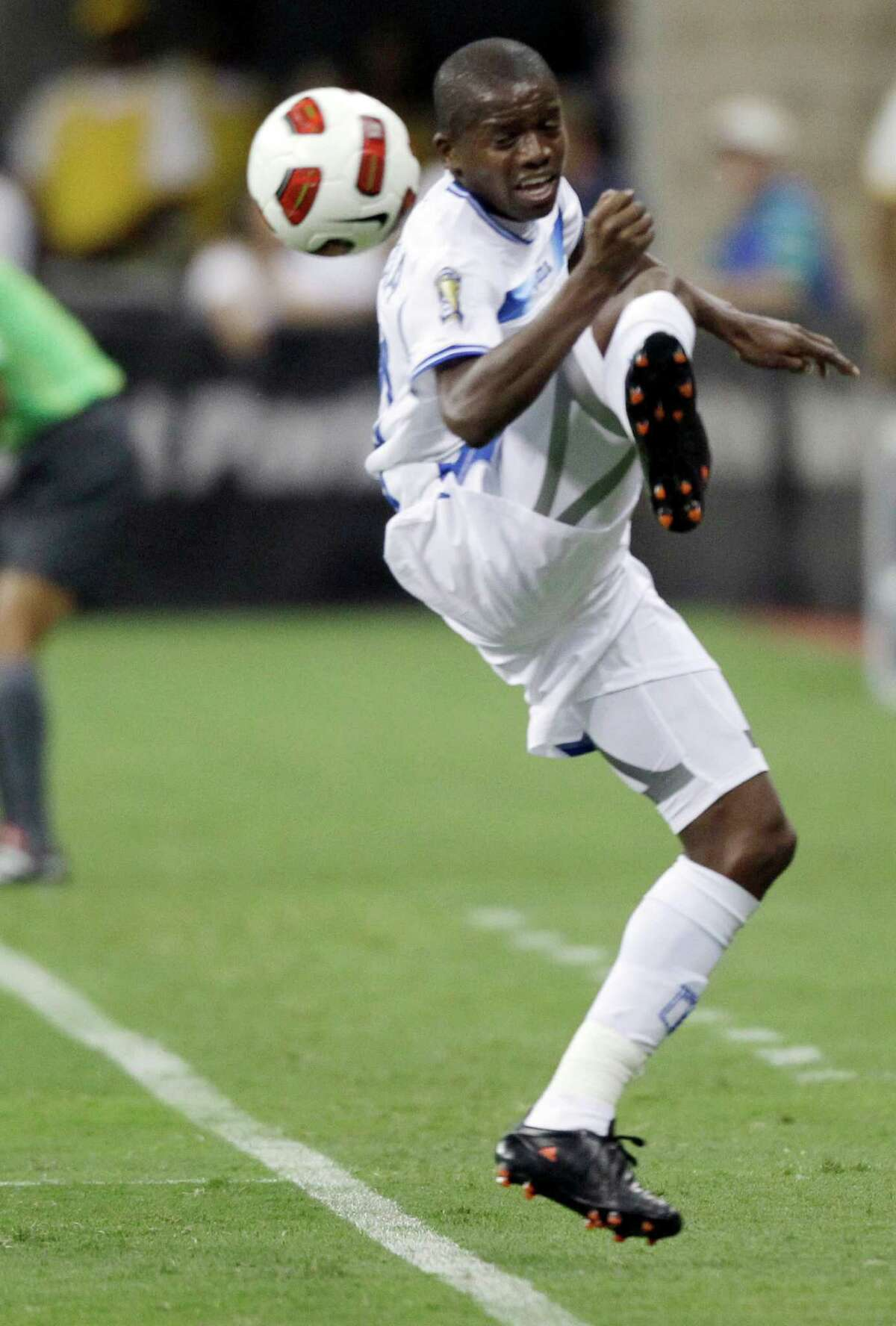 Honduras' Oscar Boniek Garcia loses the ball during the first half of a CONCACAF Gold Cup semifinal soccer match against Mexico on Wednesday, June 22, 2011, in Houston. (AP Photo/David J. Phillip)