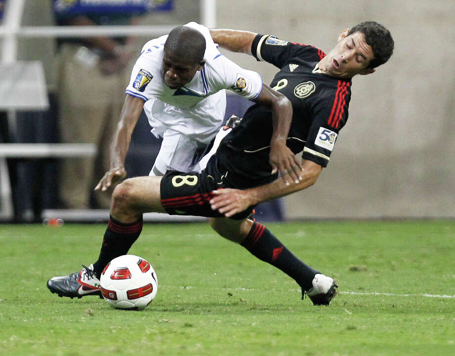 Honduras' Oscar Boniek Garcia left, collides with Mexico's Israel Castro right, during the CONCACAF Gold Cup 2011 semi-finals at Reliant Stadium Wednesday, June 22, 2011, in Houston. Photo: James Nielsen, Houston Chronicle / © 2011 Houston Chronicle