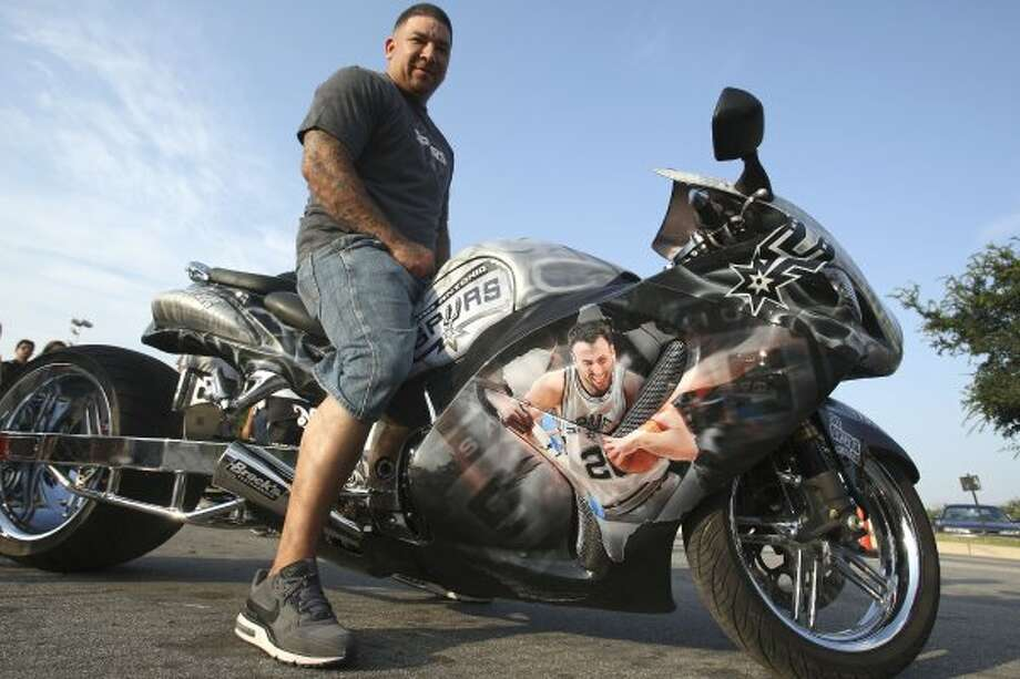 Philip Lozano sits on his San Antonio Spurs custom 2009 Suzuki Hayabusa motorcycle before game five of the NBA Western Conference Finals in San Antonio, Texas on Monday, June 4, 2012.  Lozano said he started applying Spurs details to the bike last week.