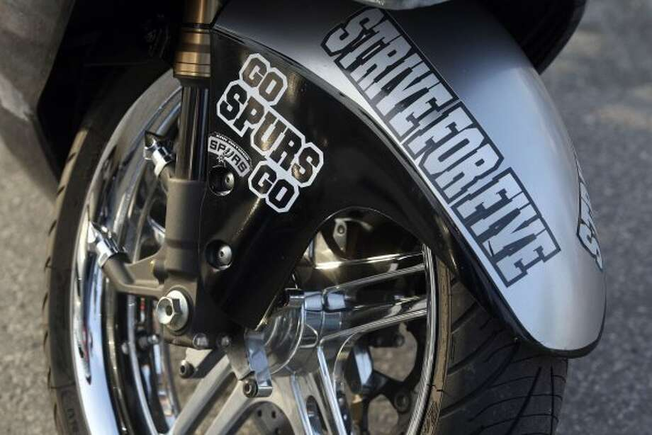 A custom Spurs 2009 Suzuki Hayabusa motorcycle in the AT&T Center parking lot before game five of the NBA Western Conference Finals in San Antonio, Texas on Monday, June 4, 2012.  Bike owner Philip Lozano said he started applying Spurs details to the bike last week. (Kevin Martin / San Antonio Express-News)