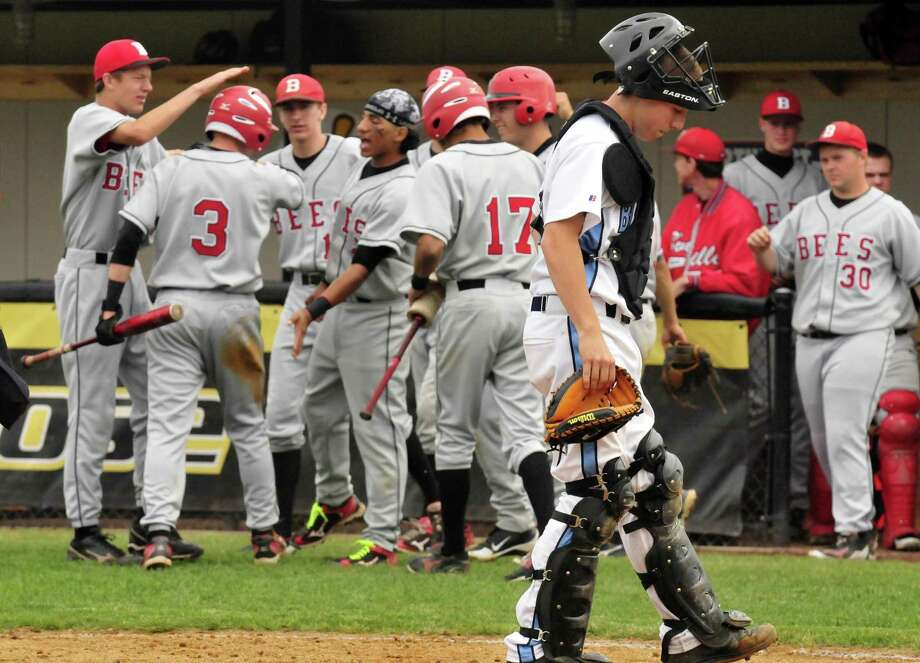 Columbia catcher Ryan Henchey walks back into position as Baldwinsville celebrate a run scored during their Class AA state regional boy's high school baseball game at the Plumeri Sports Complex in Albany N.Y. Tuesday June 5, 2012. (Michael P. Farrell/Times Union) Photo: Michael P. Farrell