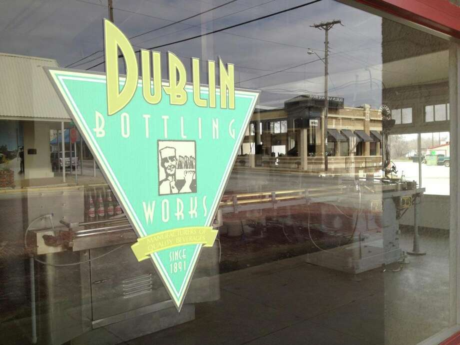 The window of Dublin's iconic bottling plant sports a new logo, but the plant still uses the same 1920s-era equipment that made it famous. Photo: Courtesy Photo