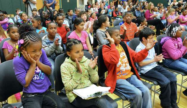 Philip J. Schuyler Achievement Academy students applaud during a band concert at the school in Albany Tuesday June 5, 2012.   $20,000 worth of musical instruments were donated by Fidelity Investments? new Albany Investor following the performance.   (John Carl D'Annibale / Times Union) Photo: John Carl D'Annibale / 00017720B