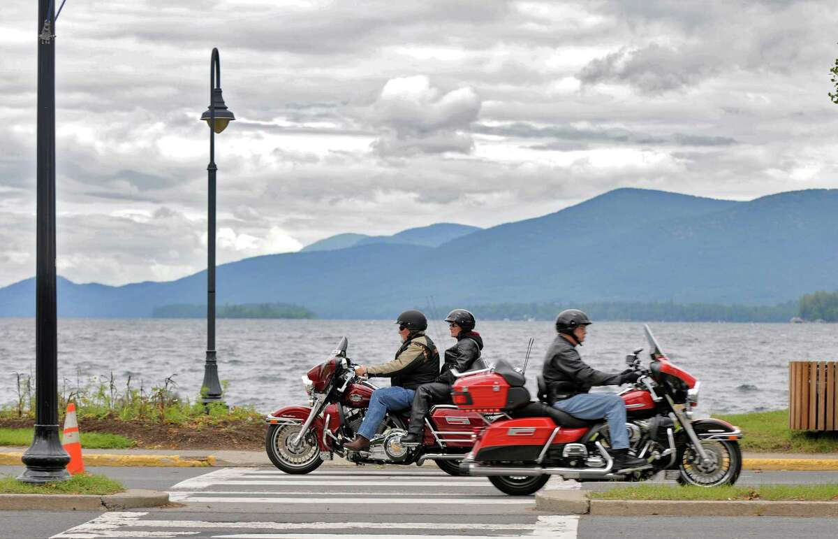 Motorcyclists pass each other on Beach Road, as bikers arrive in the village for the annual Americade, on Tuesday June 5, 2012 in Lake George, NY. (Philip Kamrass / Times Union )