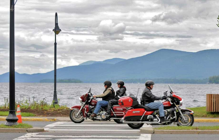 Motorcyclists pass each other on Beach Road, as bikers arrive in the village for the annual Americade, on Tuesday June 5, 2012 in Lake George, NY.  (Philip Kamrass / Times Union ) Photo: Philip Kamrass / 00017974A