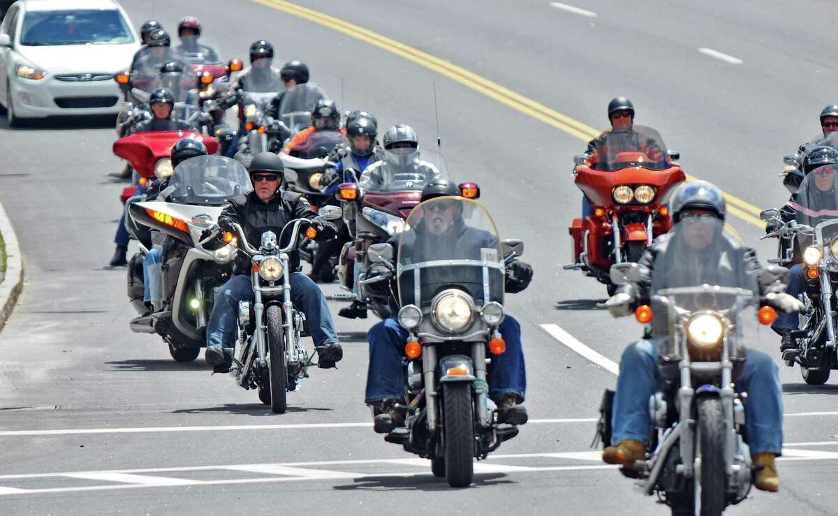 Bikers make their way along Canada Street as they arrive in the village for the annual Americade, on Tuesday June 5, 2012 in Lake George, NY. (Philip Kamrass / Times Union )