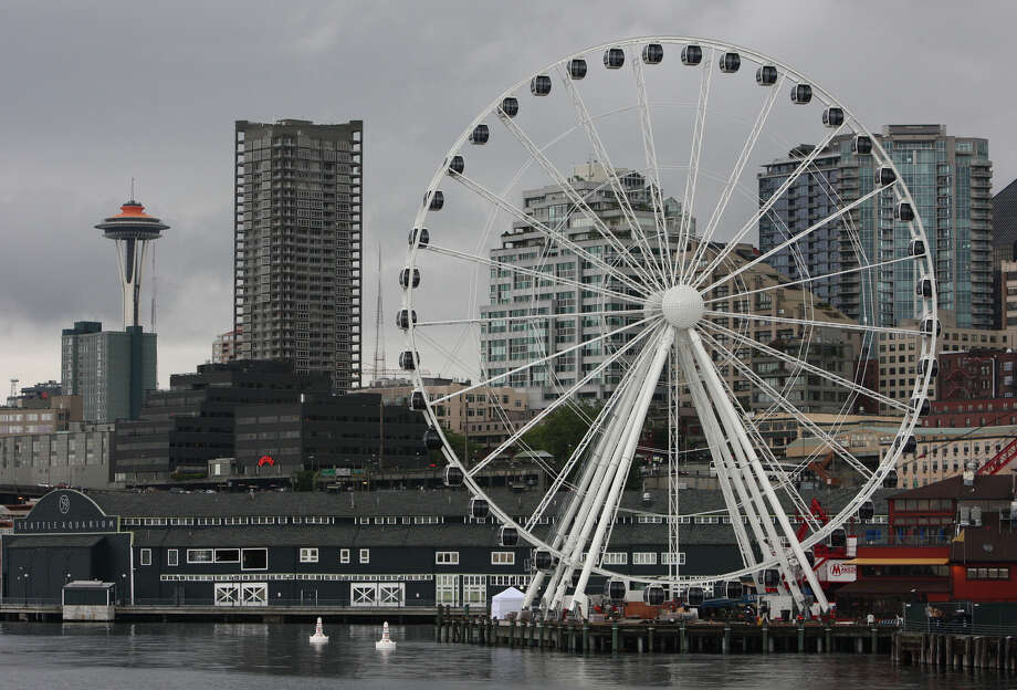 The Seattle Great Wheel is shown from Elliott Bay.  The nearly 175 foot-tall Ferris wheel being constructed at the end of Pier 57 on the Seattle waterfront will begin operation by July 4th. Each car has heating and air conditioning and the wheel can be operated year round. The massive wheel dramatically changes the Seattle skyline as seen from the water. Photo: JOSHUA TRUJILLO / SEATTLEPI.COM