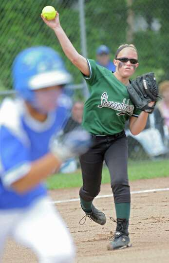 Shenendehowa pitcher Erika Daigle throws a grounder to first base during a state Class AA regional s