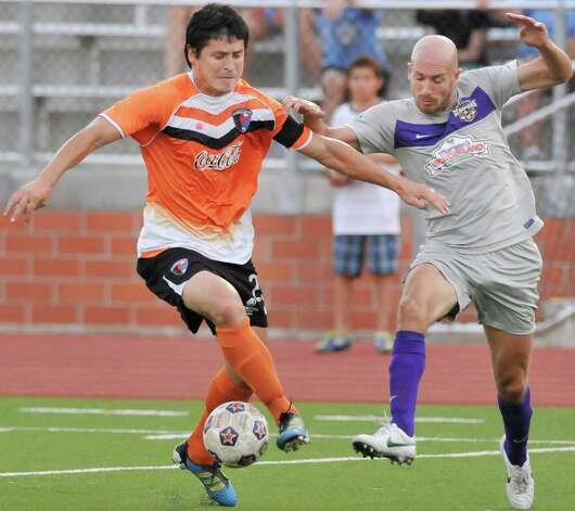 Charlotte's Josh Rife, left, is intercepted by the Scorpions' Hans Denissen during a U.S. Open Cup soccer match, Tuesday, June 5, 2012, at Heroes Stadium. Photo: Darren Abate, Express-News
