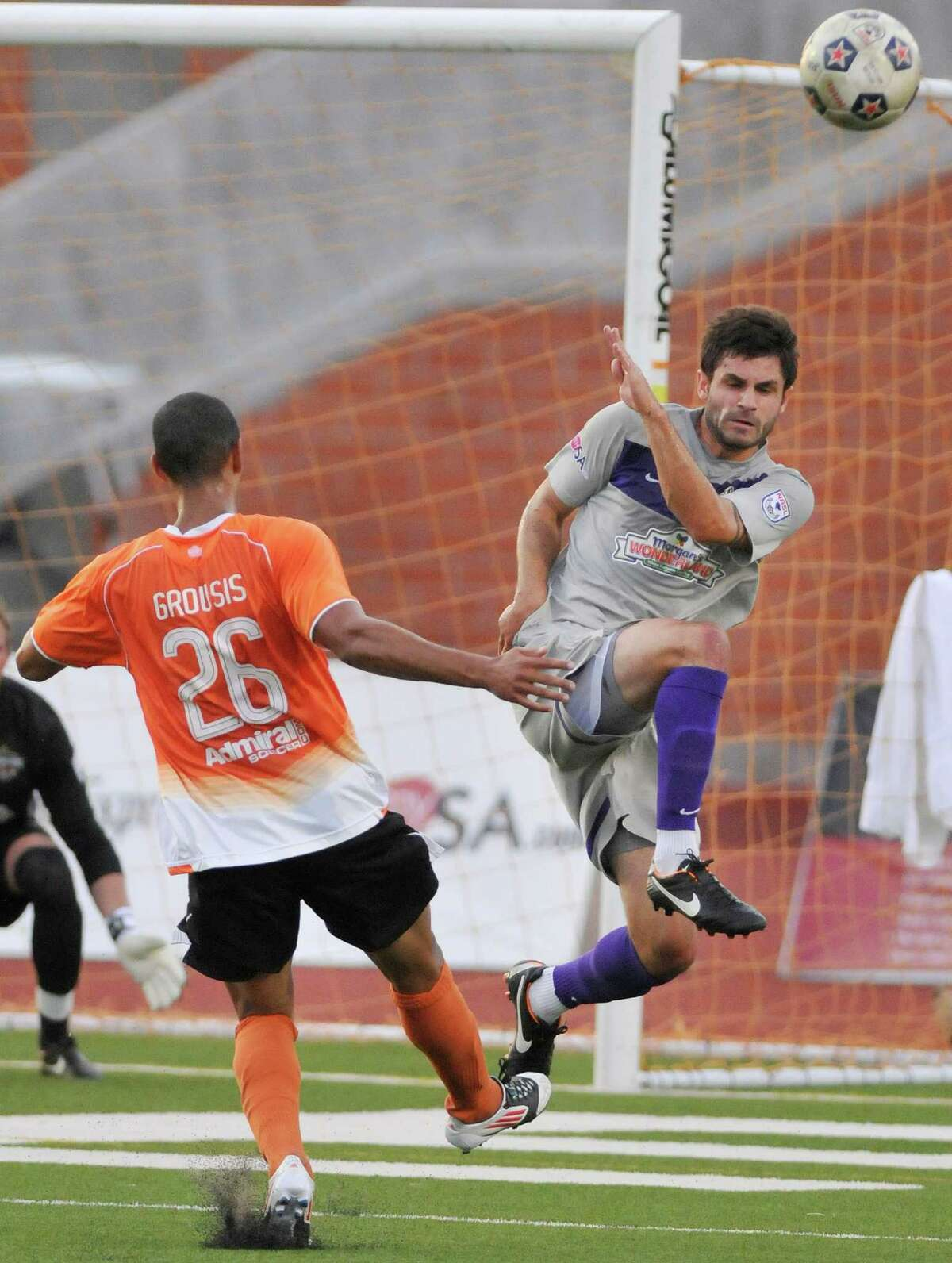 The Scorpions' Blake Wagner, right, defends against Charlotte's Devon Grousis during a U.S. Open Cup soccer match, Tuesday, June 5, 2012, at Heroes Stadium.