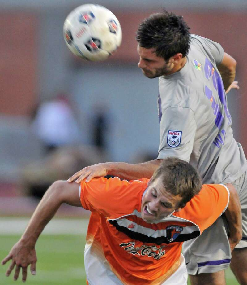 The Scorpions'  Blake Wagner, top, heads the ball over Charlotte's Nate Thornton during a U.S. Open Cup soccer match, Tuesday, June 5, 2012, at Heroes Stadium. Photo: Darren Abate, Express-News