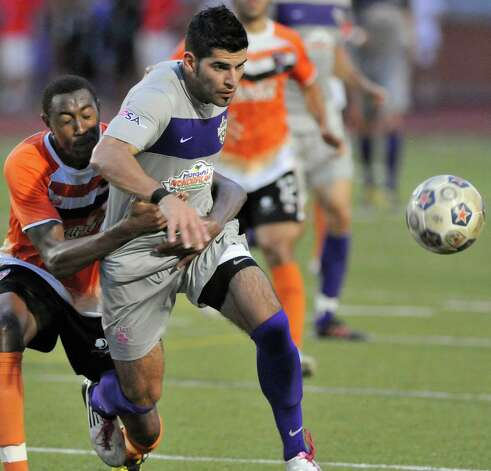 The Scorpions'  Esteban Bayona, front, is grabbed by Charlotte's Sean Bateau during a U.S. Open Cup soccer match, Tuesday, June 5, 2012, at Heroes Stadium. Photo: Darren Abate, Express-News