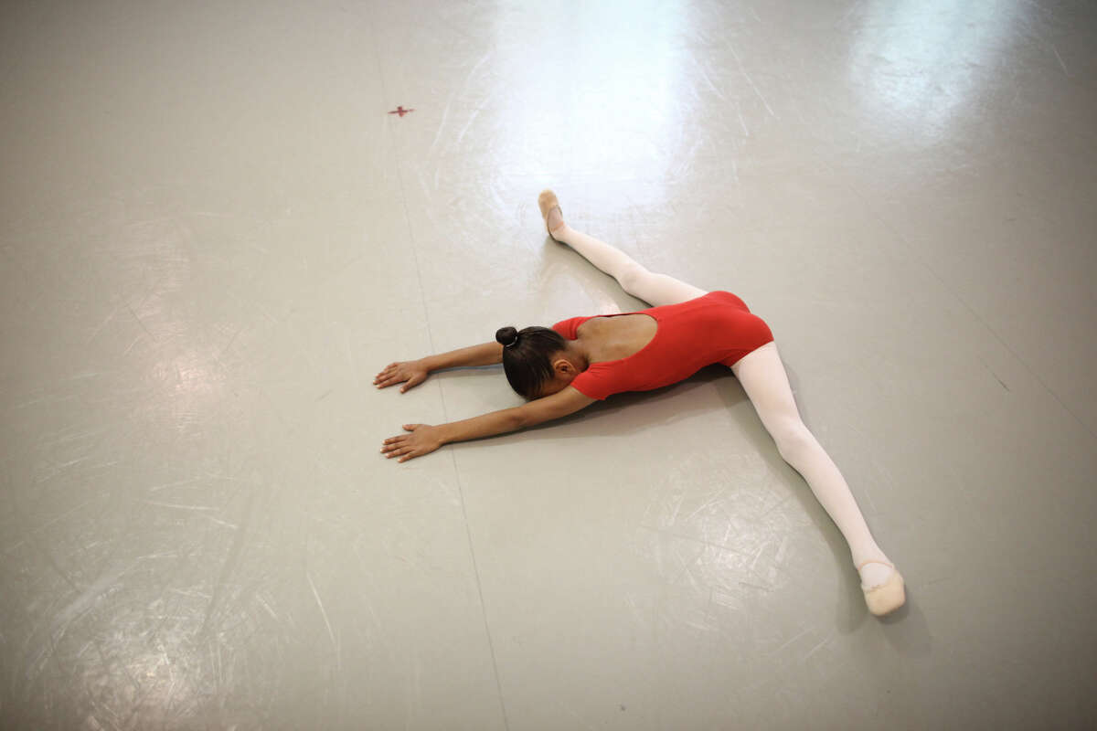 A student stretches before her performance during the 18th annual DanceChance Observation day at Pacific Northwest Ballet.