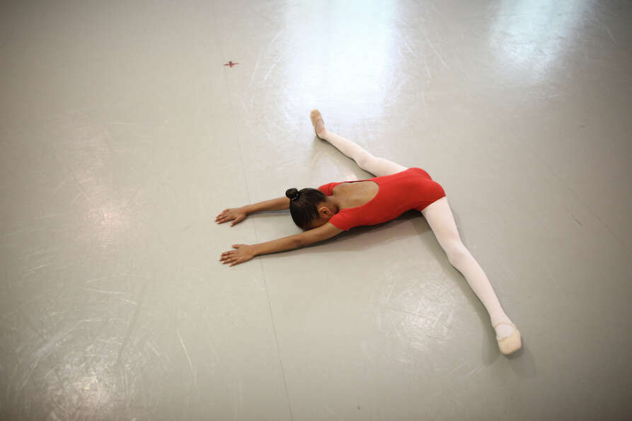 A student stretches before her performance during the 18th annual DanceChance Observation day at Pac