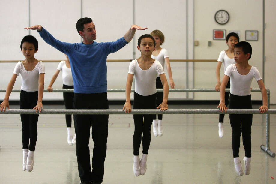 Instructor Tim Lynch sees how high students can leap during the 18th annual DanceChance Observation day performance at Pacific Northwest Ballet. Photo: JOSHUA TRUJILLO / SEATTLEPI.COM