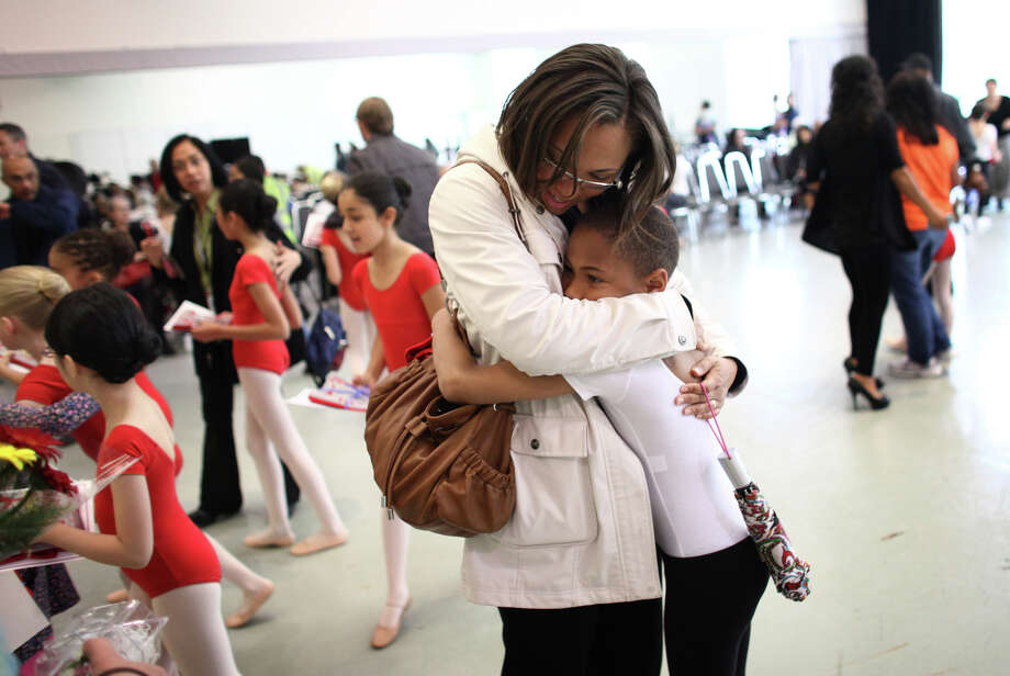 Ty Steward, 8, a third-grader at Maple Elementary, gets a hug from his mom Rachael Steward after he performed at the 18th annual DanceChance Observation day at Pacific Northwest Ballet. DanceChance students from 26 Seattle and Bellevue public schools 