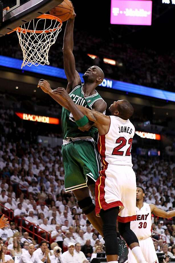 The Boston Celtics' Kevin Garnett is fouled by the Miami Heat's James Jones, right, in Game 5 of the NBA Eastern Conference Finals, Tuesday, June 5, 2012, at AmericanAirlines Arena in Miami, Florida. Boston claimed a 3-2 series lead with a 94-90 victory. (Gary Coronado/Palm Beach Post/MCT) Photo: Gary Coronado, McClatchy-Tribune News Service