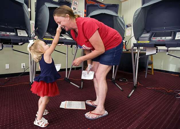 "Sadie Summer O'Neal, 2, puts an ""I Voted"" sticker on the nose of her grandmother, Kathleen Rogers, during voting at the Teen Driving Academy polling station in Placentia, Calif., on Tuesday, June 5, 2012. California's primary election was providing the first statewide run on a top-two voting system and newly redrawn legislative and congressional districts. Voters also were weighing in on a cigarette tax and changes to term limits. (AP Photo/The Orange County Register, Jebb Harris) MANDATORY CREDIT; MAGS OUT; LOS ANGELES TIMES OUT Photo: Jebb Harris, Associated Press"