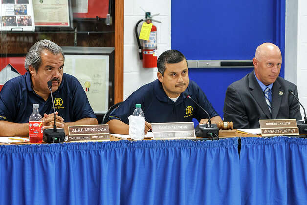 Harlandale ISD school board vice president Zeke Mendoza (from left), president David Abundis and departing superintendent Robert Jaklich listen to input from citizens during a special meeting of the Harlandale ISD school board on Tuesday, June 5, 2012, to discuss the 2012-2013 budget as well as the search for a new superintendent. Jaklich is leaving to become the superintendent in Victoria. Photo: Marvin Pfeiffer, San Antonio Express-News / Express-News 2012