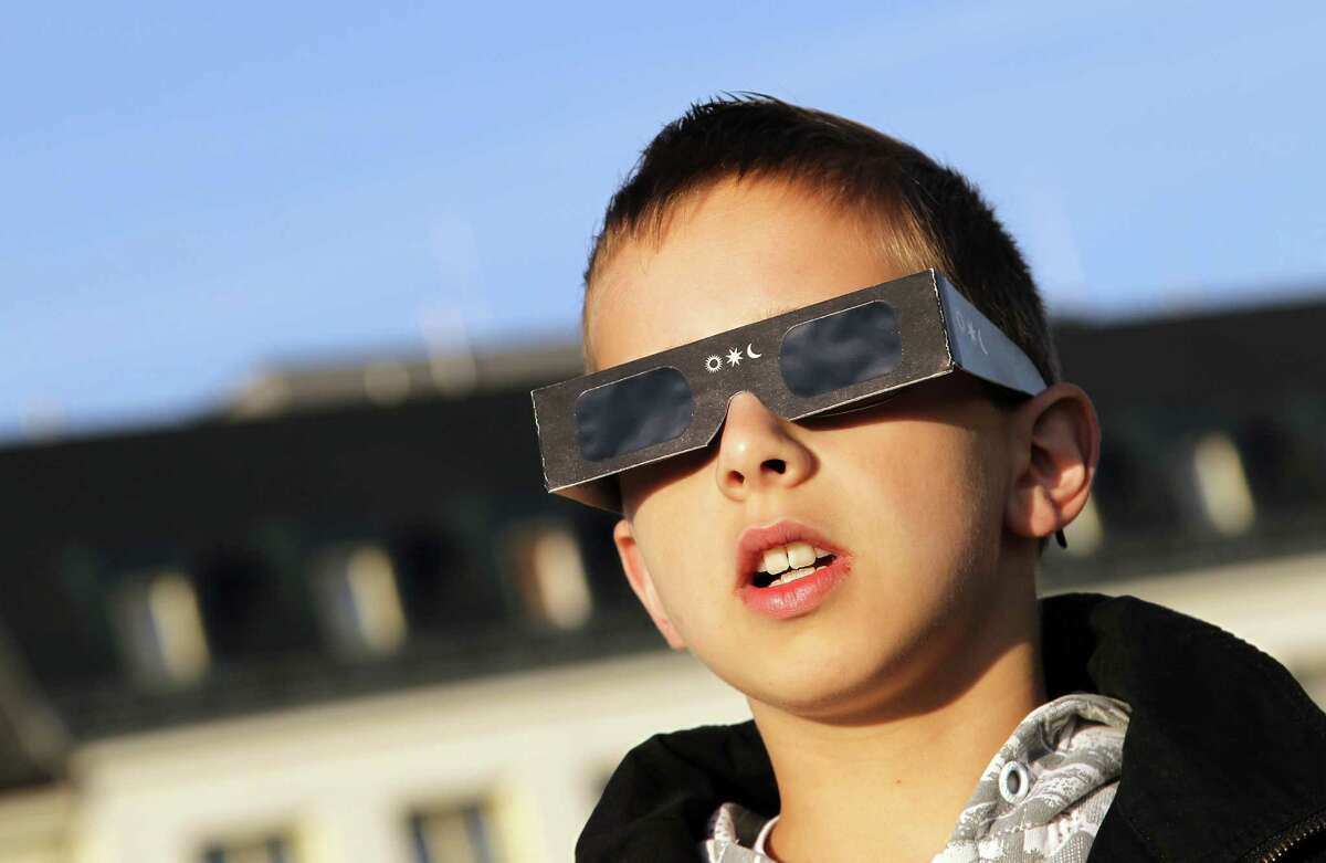 A child uses special protection glasses to see the transit of Venus crossing in front of the Sun, at the Urania observatory, in Vienna on June 6, 2012. Sky-gazers around the world held up their telescopes and viewing glasses to watch Venus slide across the sun a rare celestial phenomenon that will not happen again for more than 100 years. AFP PHOTO / ALEXANDER KLEINALEXANDER KLEIN/AFP/GettyImages