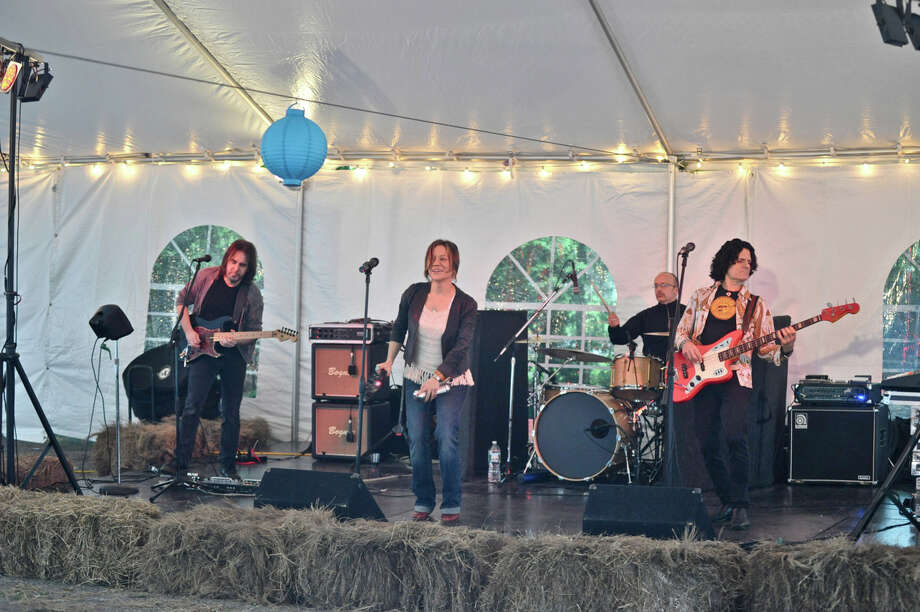 Local rock band Tangled Vine takes the stage at the New Canaan Library's Books, Blues, & BBQ fundraiser Friday, June 1, 2012. Photo by Henry Eschricht, New Canaan, Conn. Photo: Contributed Photo
