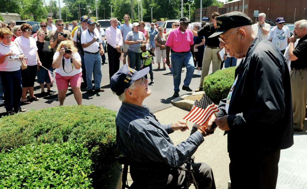 World War II veterans Bob Lawton, right, and Guy Deane talk before leaving Tuesday, June 5, 2012, from Owensboro, Ky.,on their journey to Washington to visit the war memorials on Wednesday, the anniversary of D-Day. The Honor Flight Network, which is a nonprofit organization created to honor America's military veterans, is taking veterans who served during World War II to Washington. (AP Photo/The Messenger-Inquirer, Jenny Sevcik)