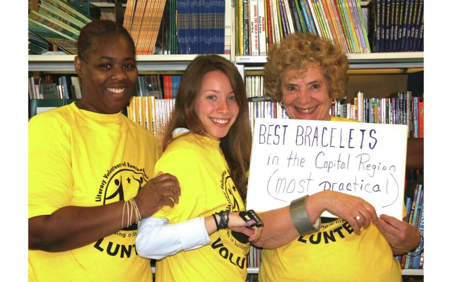 "Members of the Literacy Volunteers of Rensselaer County band together to Occupy Best Of. Barbara Wyman, who submitted the photo, writes, ""We are practical and yet have lots of fun at Literacy Volunteers of Rensselaer County, and we have the best bracelets -- rubber bands, thumb drives and duct tape!"" (Barbara Wyman)"