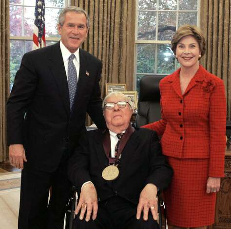 "This 2004 White House photo shows former US President George W. Bush, author Ray Bradley(C) and First Lady Laura Bush after Bradley accepted the 2004 National Medal of Arts award in Washington,DC. Ray Bradbury, the science fiction legend who penned ""Fahrenheit 451"" and ""The Martian Chronicles,"" has died at the age of 91, his family said June 6, 2012. ""The world has lost one of the best writers it's ever known, and one of the dearest men to my heart. RIP Ray Bradbury (Ol' Gramps),"" tweeted his grandson Danny Karapetian. Ray Bradbury's fiction served as cautionary tales about perilous futures. In all, the award-winning writer penned nearly 600 short stories and 30 books, including ""The Martian Chronicles"" about human attempts to colonize Mars and the unintended consequences. AFP PHOTO/THE WHITE HOUSE/SUSAN STERNER/HANDOUT/RESTRICTED TO EDITORIAL USE - MANDATORY CREDIT "" AFP PHOTO / - NO MARKETING NO ADVERTISING CAMPAIGNS - DISTRIBUTED AS A SERVICE TO CLIENTS 