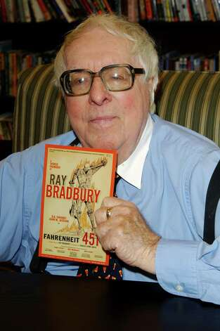 "Author Ray Bradbury  signs his new book ""Bradbury:  An Illustrated Life"" at Barnes & Noble on October 19, 2002 in Los Angeles, California. It was reported on June 6, 2012 that science-fiction author Ray Bradbury has died at 91 in Los Angeles. Photo: Jon Kopaloff, Getty Images / 2002 Getty Images"