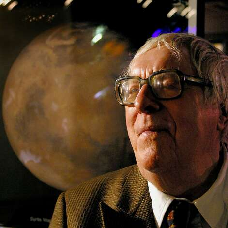 Science fiction author Ray Bradbury sits in front of a photo of Mars, presented to him during an 83rd birthday party in his honor Saturday, Aug. 23, 2003, at The Planetary Society in Pasadena, Calif. Photo: STEFANO PALTERA, AP / AP